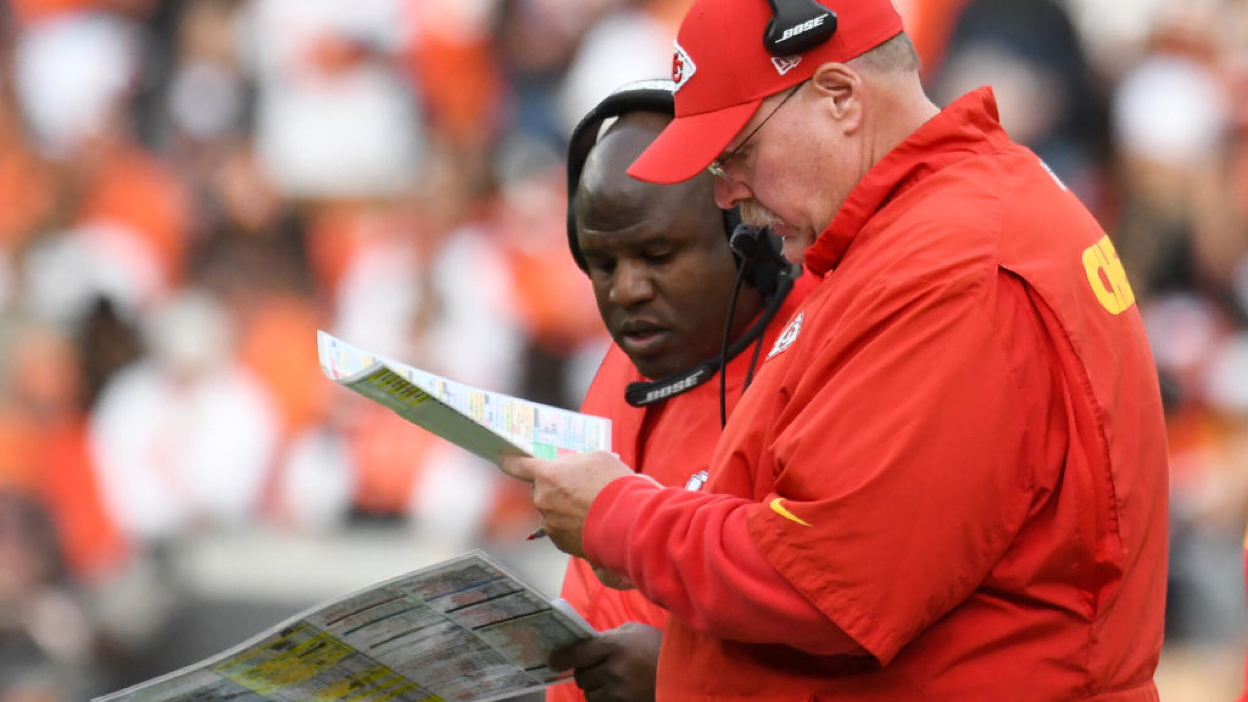 CLEVELAND, OH - NOVEMBER 4, 2018: Head coach Andy Reid and offensive coordinator Eric Bieniemy of the Kansas City Chiefs talk on the sideline in the fourth quarter of a game against the Cleveland Browns on November 4, 2018 at FirstEnergy Stadium in Cleveland, Ohio. Kansas City won 37-21. (Photo by: 2018 Nick Cammett/Diamond Images/Getty Images)