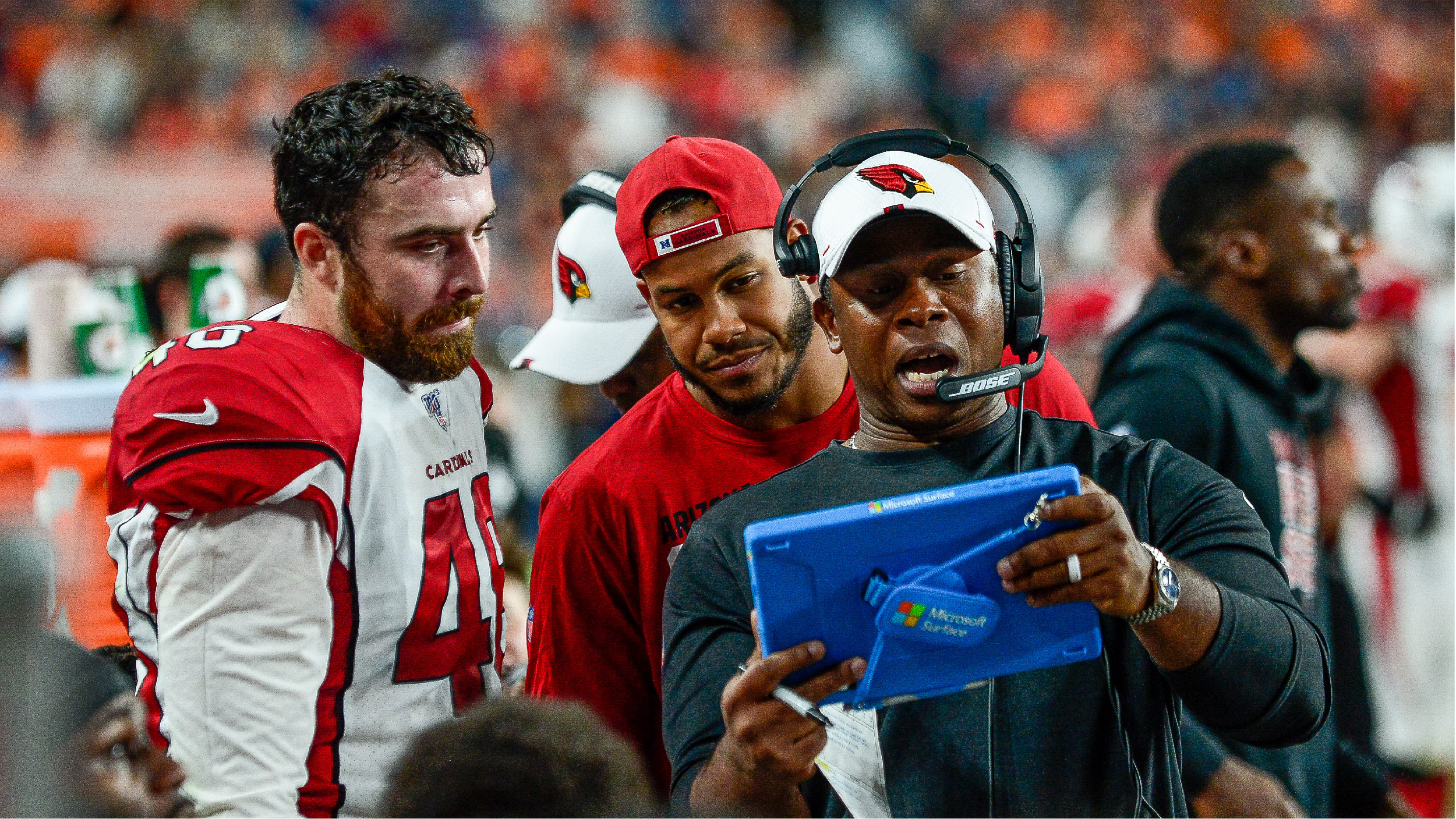 DENVER, CO - AUGUST 29: Offensive coordinator Vance Joseph of the Arizona Cardinals has a word with Tanner Vallejo #48 in the bench area during a game against the Denver Broncos during a preseason National Football League game at Broncos Stadium at Mile High on August 29, 2019 in Denver, Colorado. (Photo by Dustin Bradford/Getty Images)