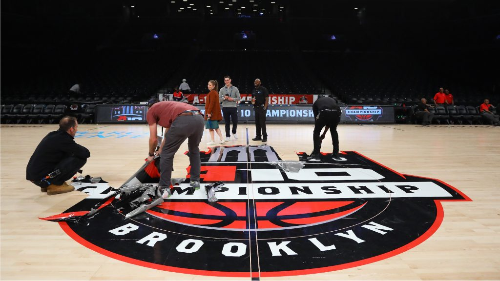 NEW YORK, NEW YORK - MARCH 12: The court is dismantled following the announcement that the 2020 Atlantic 10 Men's Basketball Tournament has been cancelled on March 12, 2020 in the Brooklyn Borough of New York City. Tournament games have been cancelled amid growing concerns of the spread of COVID-19 (Coronavirus). (Photo by Mike Stobe/Getty Images)