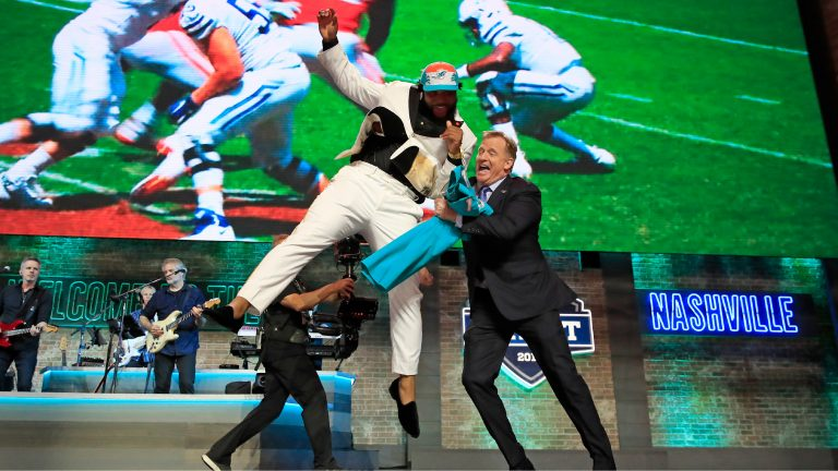NASHVILLE, TENNESSEE: Christian Wilkins of Clemson celebrates with NFL Commissioner Roger Goodell after being chosen #13 overall by the Miami Dolphins during the first round of the 2019 NFL Draft on April 25, 2019 in Nashville, Tennessee. (Photo by Andy Lyons/Getty Images)