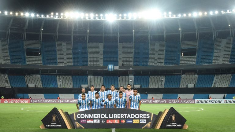 AVELLANEDA, ARGENTINA - MARCH 12: Players of Racing Club pose for the team photo prior to a Group F match between Racing Club and Alianza Lima as part of Copa CONMEBOL Libertadores 2020 at Juan Domingo Peron Stadium on March 12, 2020 in Avellaneda, Argentina. The match is played behind closed doors to prevent the spread of the novel Coronavirus (COVID-19). (Photo by Marcelo Endelli/Getty Images)