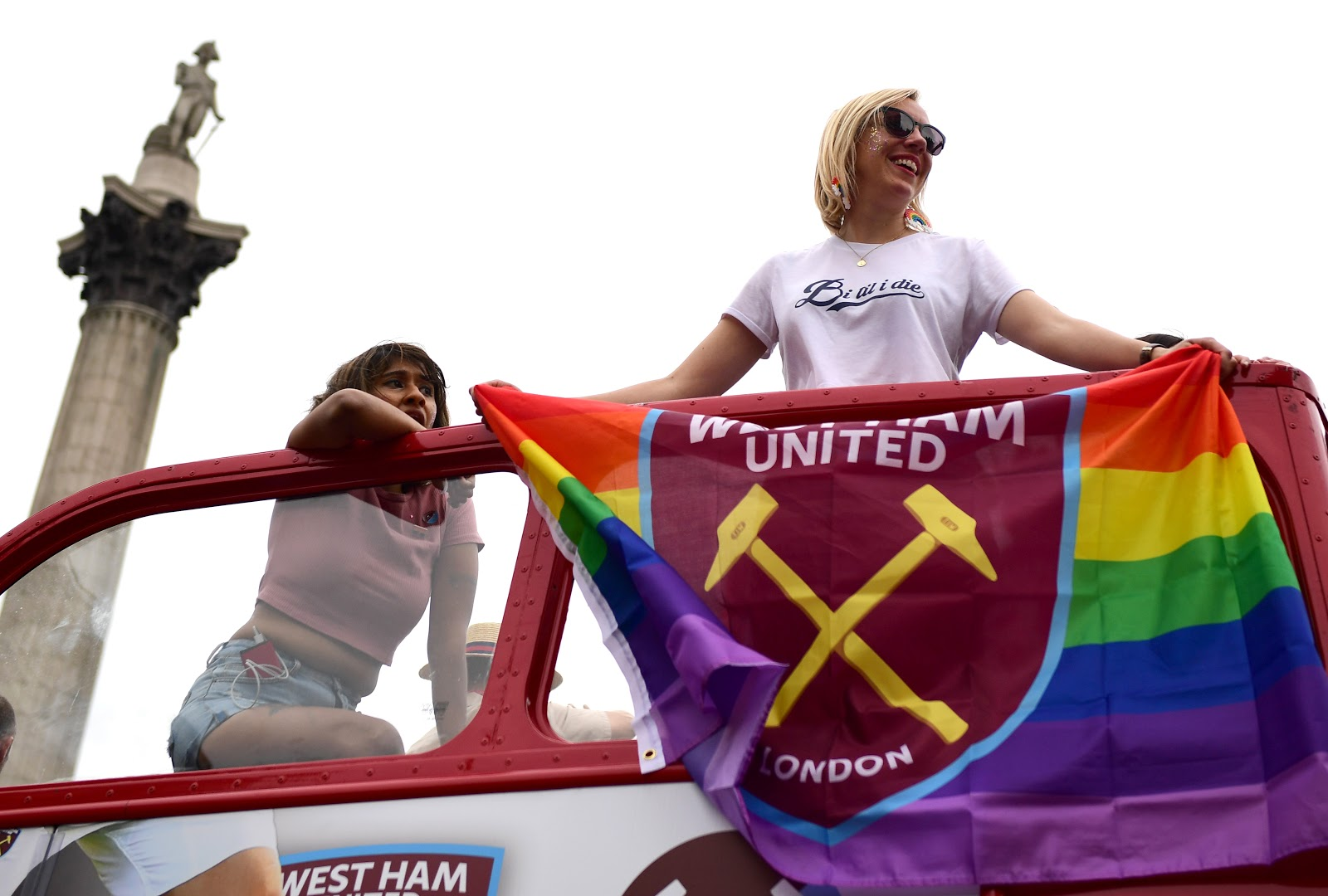 Pride supporters on a bus in London