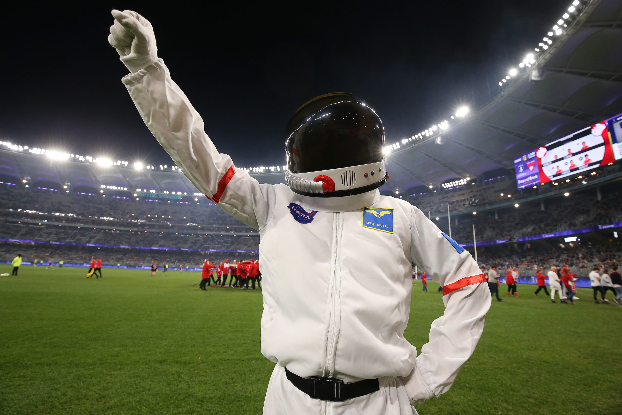 PERTH, AUSTRALIA - JULY 20: A mascot dressed an astronaut poses to commemorate the Apollo 11 moon landing during the round 18 AFL match between the Fremantle Dockers and the Sydney Swans at Optus Stadium on July 20, 2019 in Perth, Australia. (Photo by Paul Kane/Getty Images)