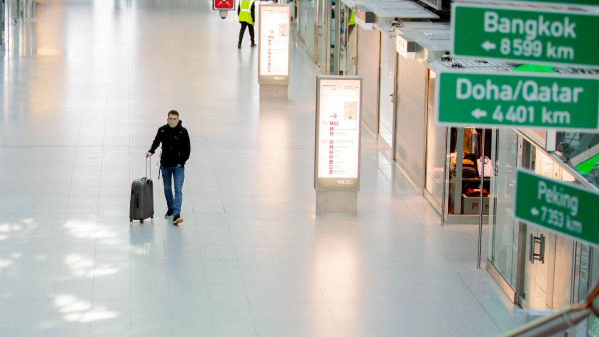 15 June 2020, Berlin: A passenger walks through the largely empty Terminal A at Berlin-Tegel Airport. The travel warning for 27 European countries was lifted during the night to Monday (15.06.2020). Photo: Christoph Soeder/dpa (Photo by Christoph Soeder/picture alliance via Getty Images)