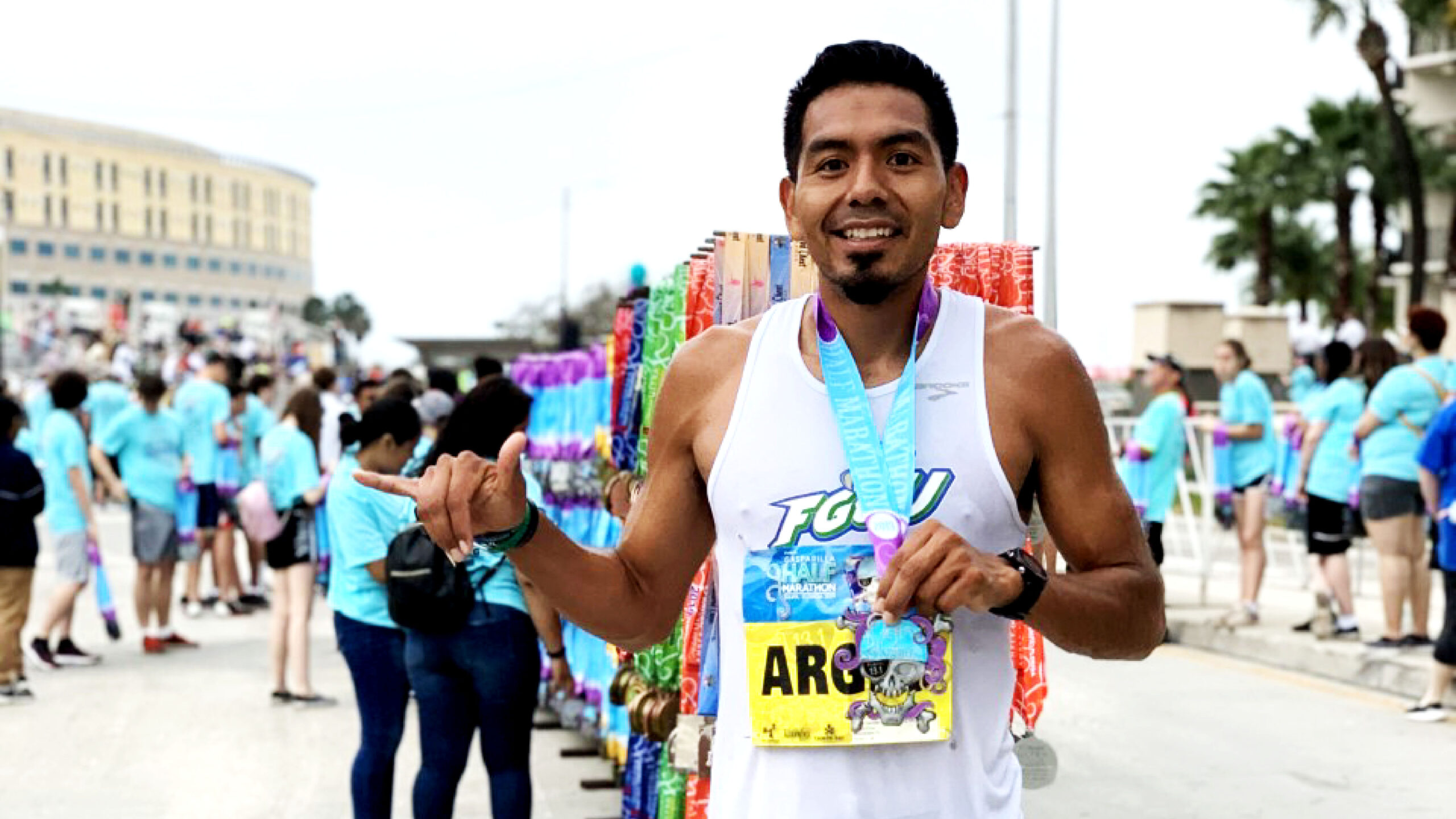 Argeo Cruz poses with a medal around his neck after finishing a race. (Photo courtesy Argeo Cruz)
