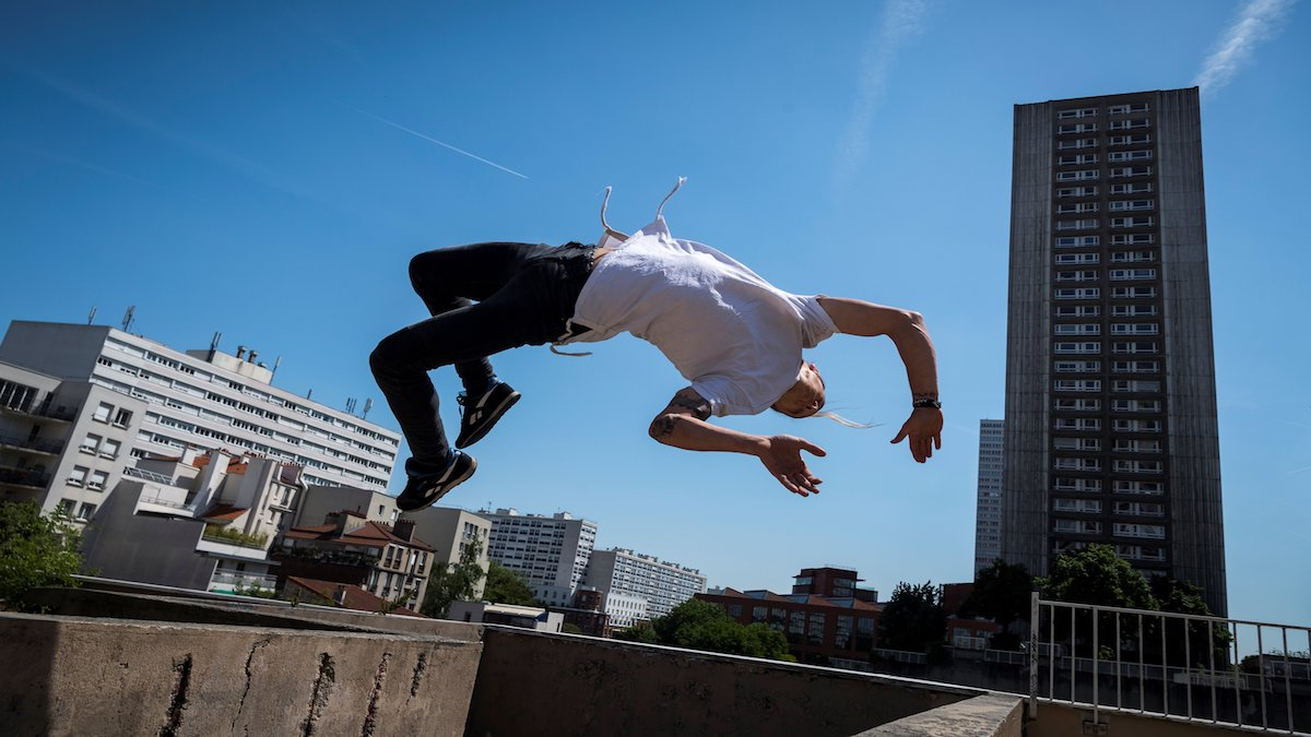 Man doing Parkour in a city
