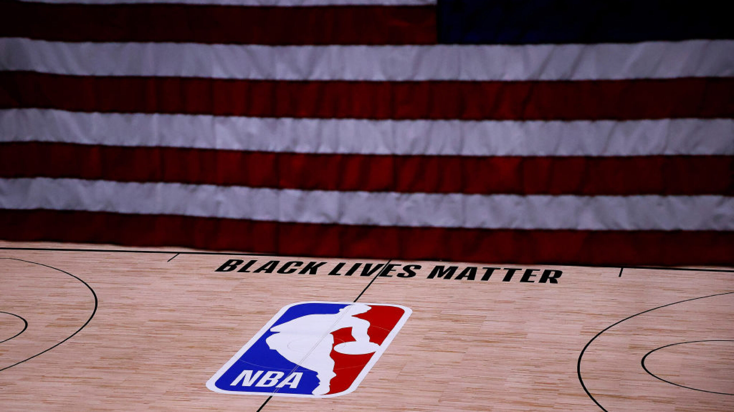 LAKE BUENA VISTA, FLORIDA - AUGUST 27: The Black Lives Matter logo is seen on an empty court as all NBA playoff games were postponed today during the 2020 NBA Playoffs at The Field House at ESPN Wide World Of Sports Complex on August 27, 2020 in Lake Buena Vista, Florida. NBA players have reportedly decided to resume the season after their walkout of playoff games on Wednesday to protest the shooting of Jacob Blake in Kenosha, Wisconsin. (Photo by Kevin C. Cox/Getty Images)
