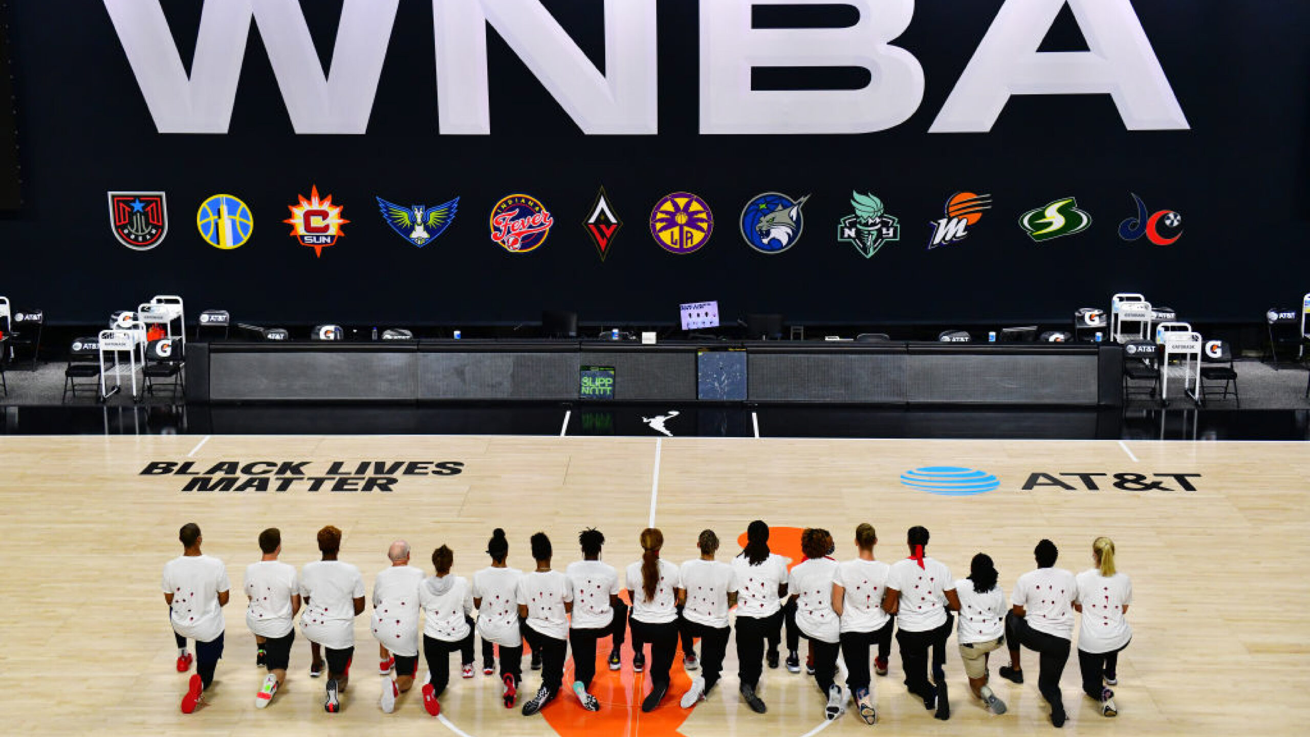 PALMETTO, FLORIDA - AUGUST 26: After the WNBA announcement of the postponed games for the evening, the Washington Mystics each wear white T-shirts with seven bullets on the back protesting the shooting of Jacob Blake by Kenosha, Wisconsin police at Feld Entertainment Center on August 26, 2020 in Palmetto, Florida. (Photo by Julio Aguilar/Getty Images)