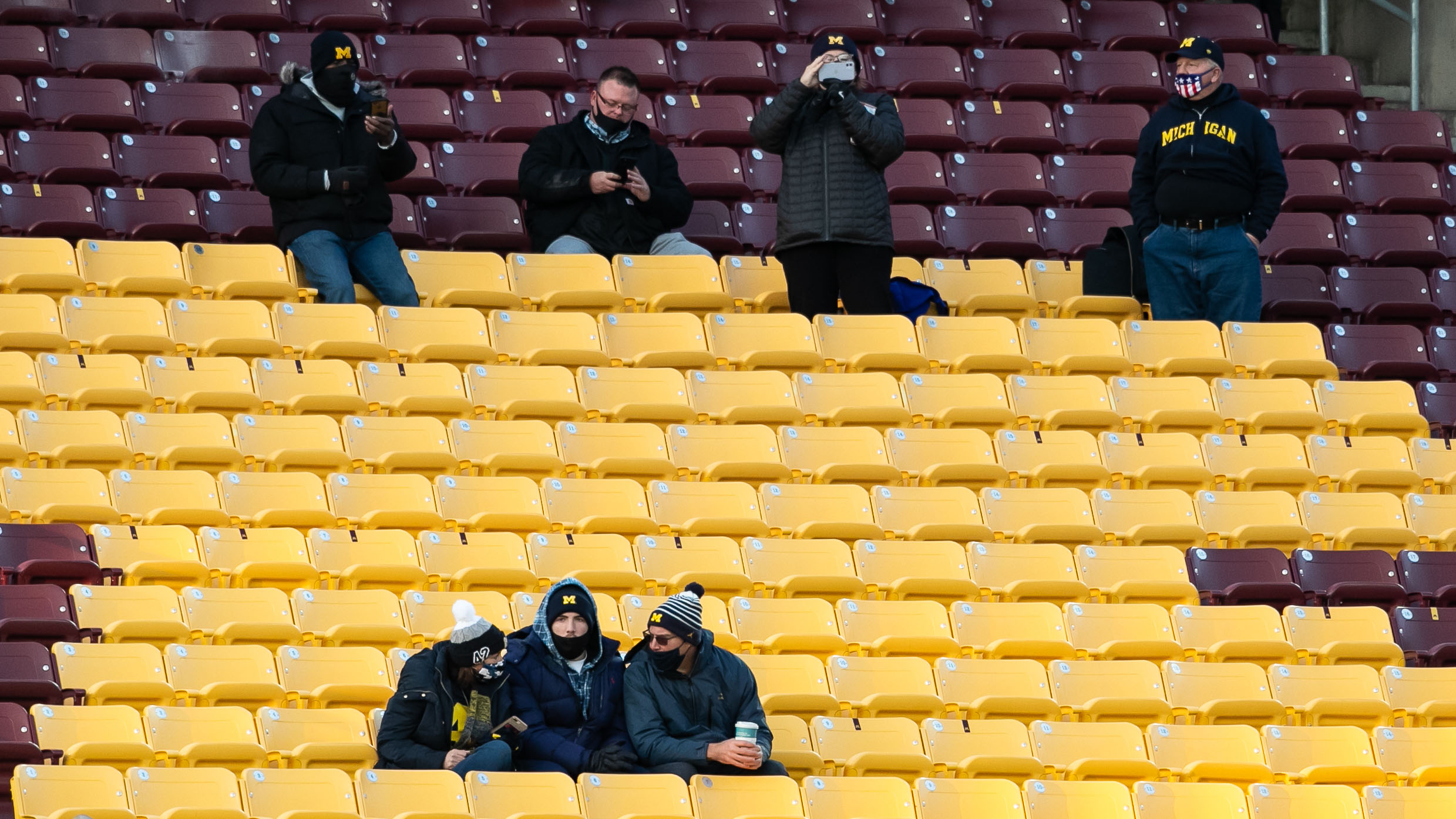 Michigan fans sitting socially distant with masks on