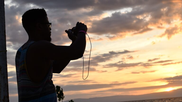 Rhasaan Nichols taking a photo of the sunset in Haiti