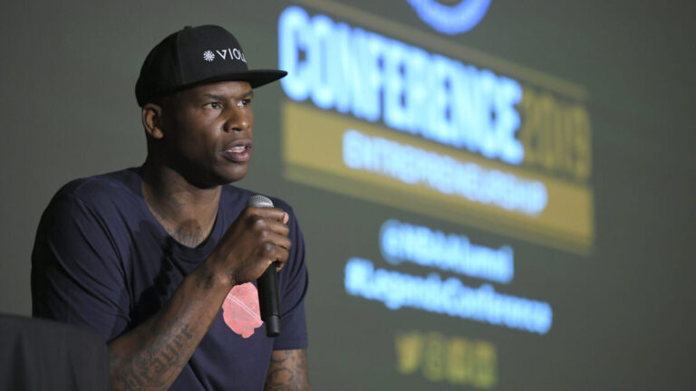 Al Harrington speaking at a conference
