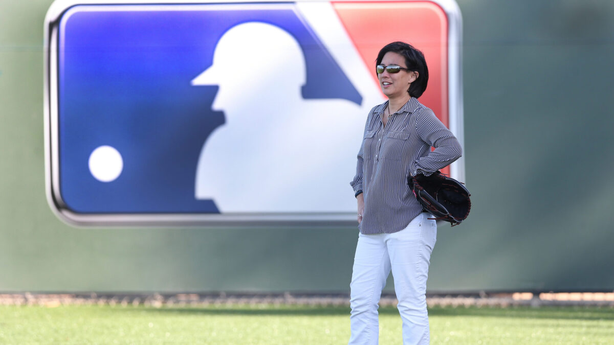 Photo of Kim Ng standing on a MLB field