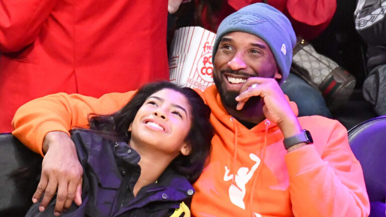Kobe and Gianna Bryant courtside at a basketball game