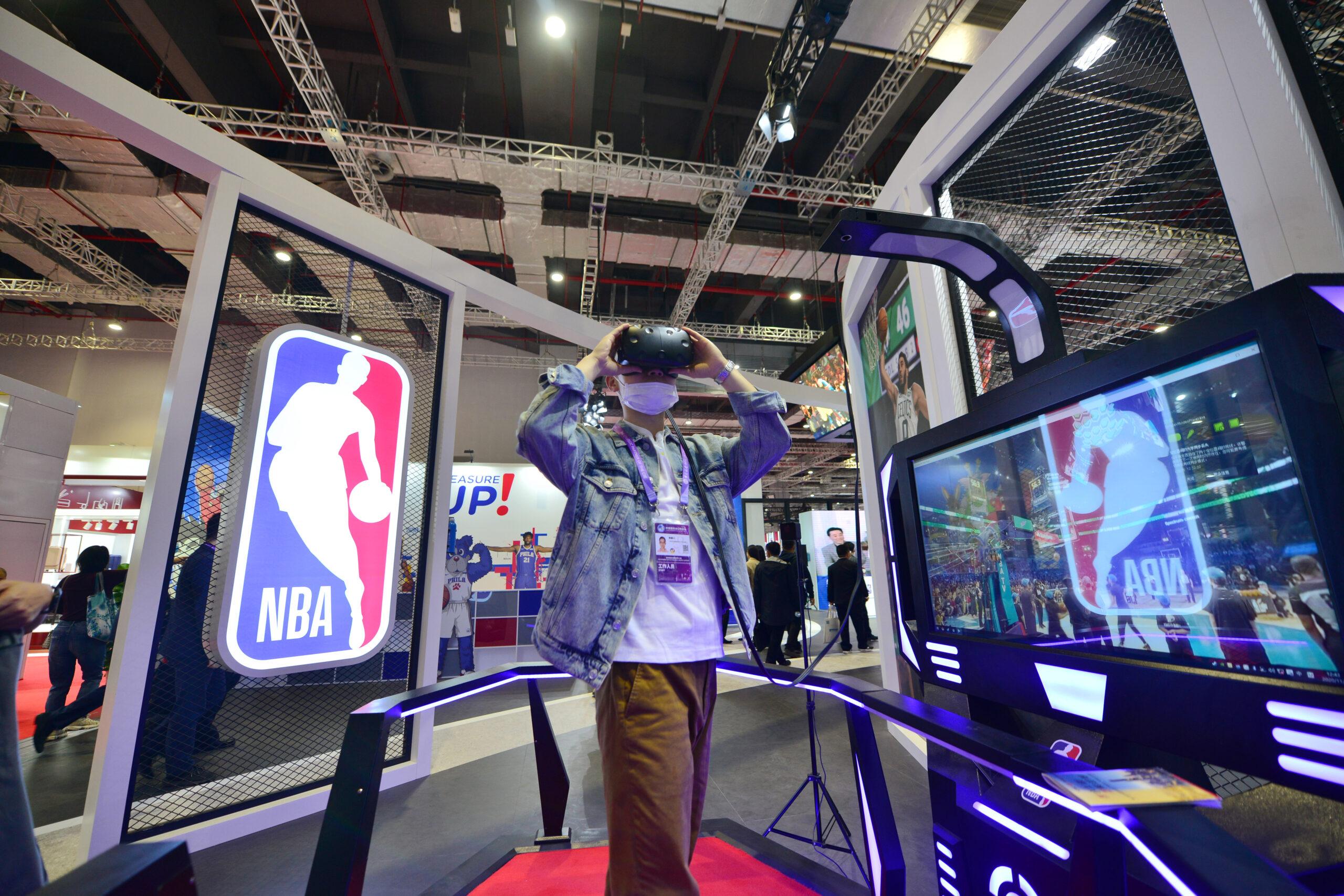 A person using the NBA virtual reality headset.