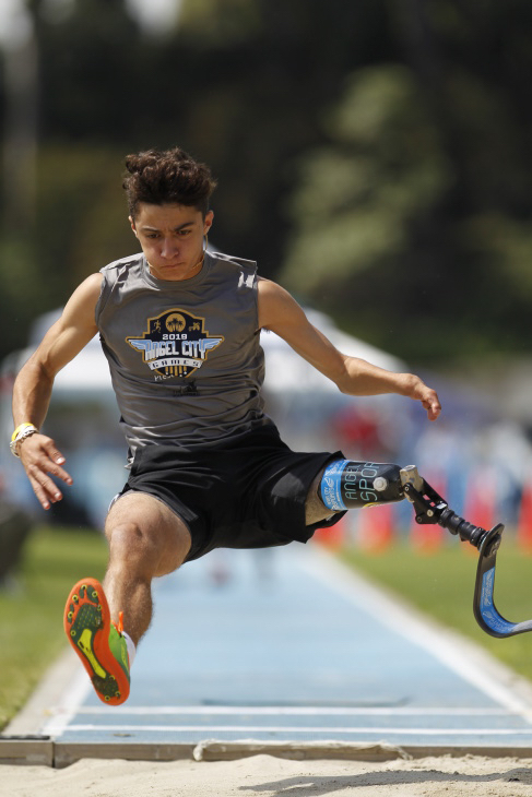 Ezra Frech shown mid-air doing the long jump. (Photo courtesy of Angel City Sports)