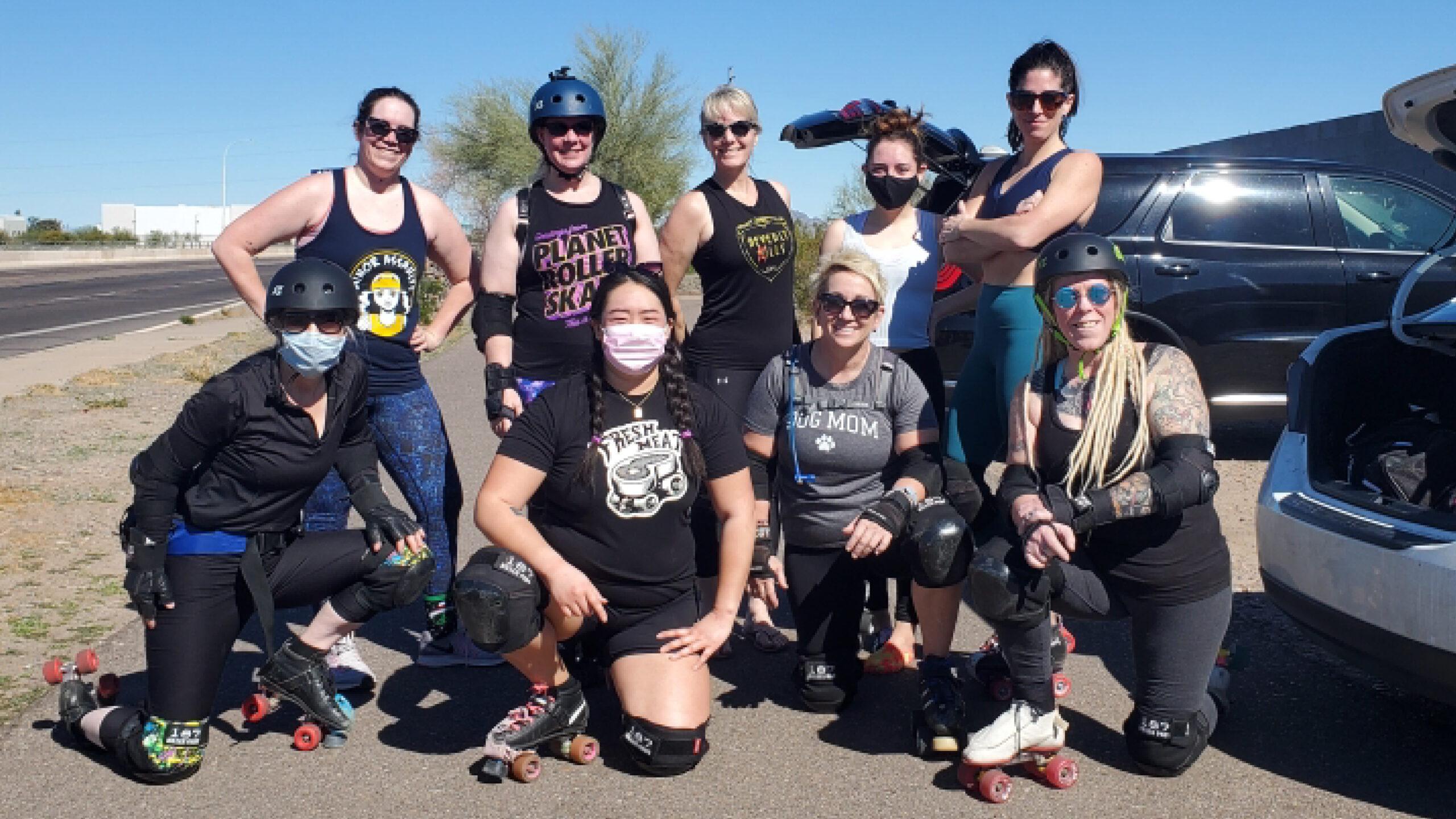 Devoney Looser on the far left, bottom, with Arizona Derby Dames (AZDD) Fresh Meat training team and coaches. (Photo courtesy Devoney Looser)