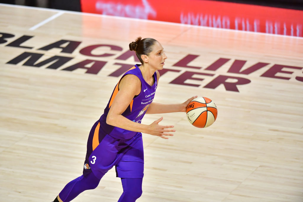 PALMETTO, FLORIDA - JULY 29: Diana Taurasi #3 of the Phoenix Mercury dribbles past a Black Lives Matter graphic on the court during the first half of a game against the Indiana Fever at Feld Entertainment Center on July 29, 2020 in Palmetto, Florida. (Photo by Julio Aguilar/Getty Images)