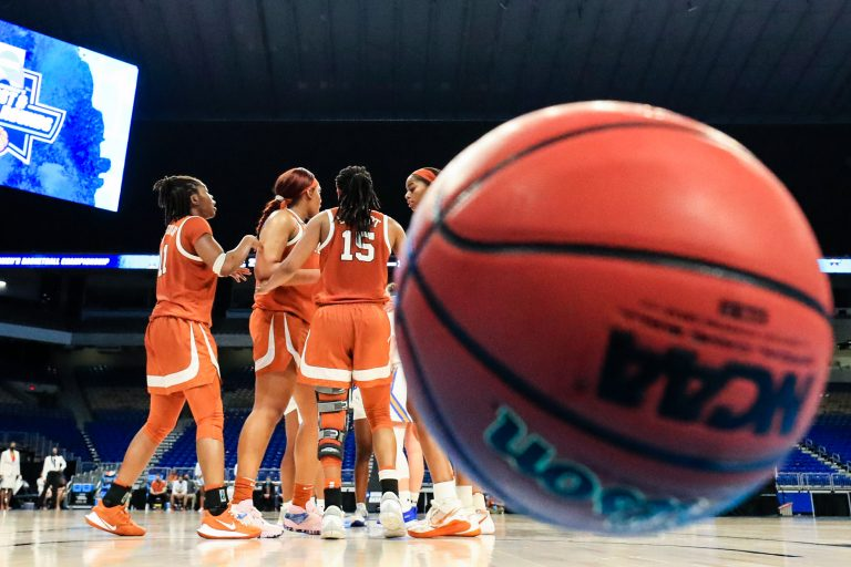 SAN ANTONIO, TEXAS - MARCH 24: Texas Longhorns huddle during the second half against the UCLA Bruins in the second round game of the 2021 NCAA Women's Basketball Tournament at the Alamodome on March 24, 2021 in San Antonio, Texas. (Photo by Carmen Mandato/Getty Images)