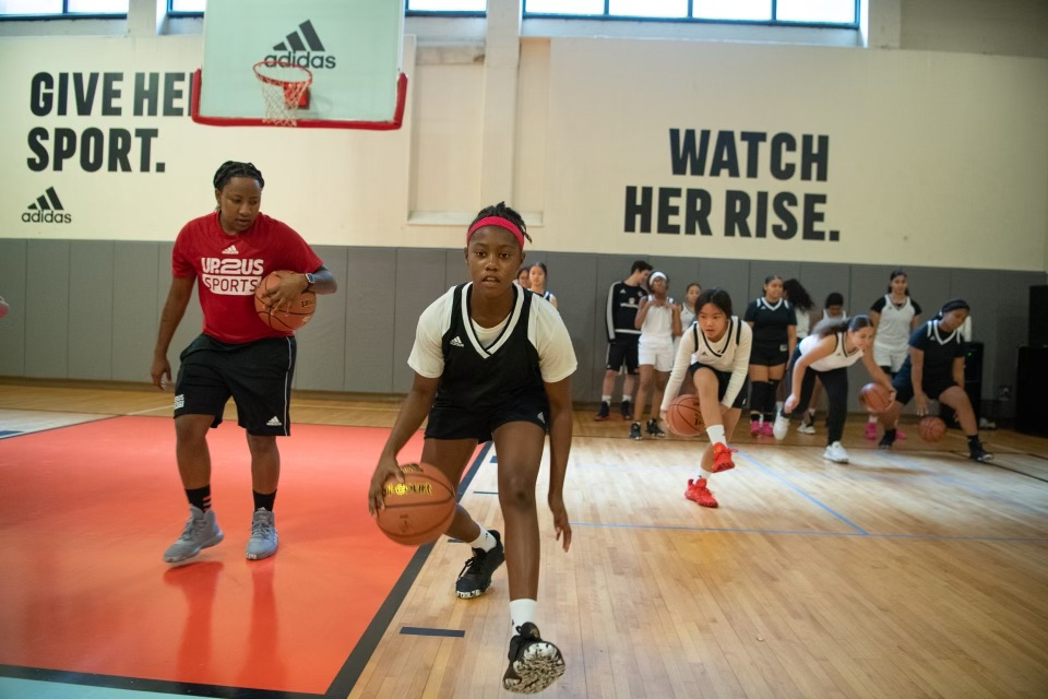 Youth basketball players practicing drills with coaches on the basketball court (Photo courtesy Up2Us Sports)