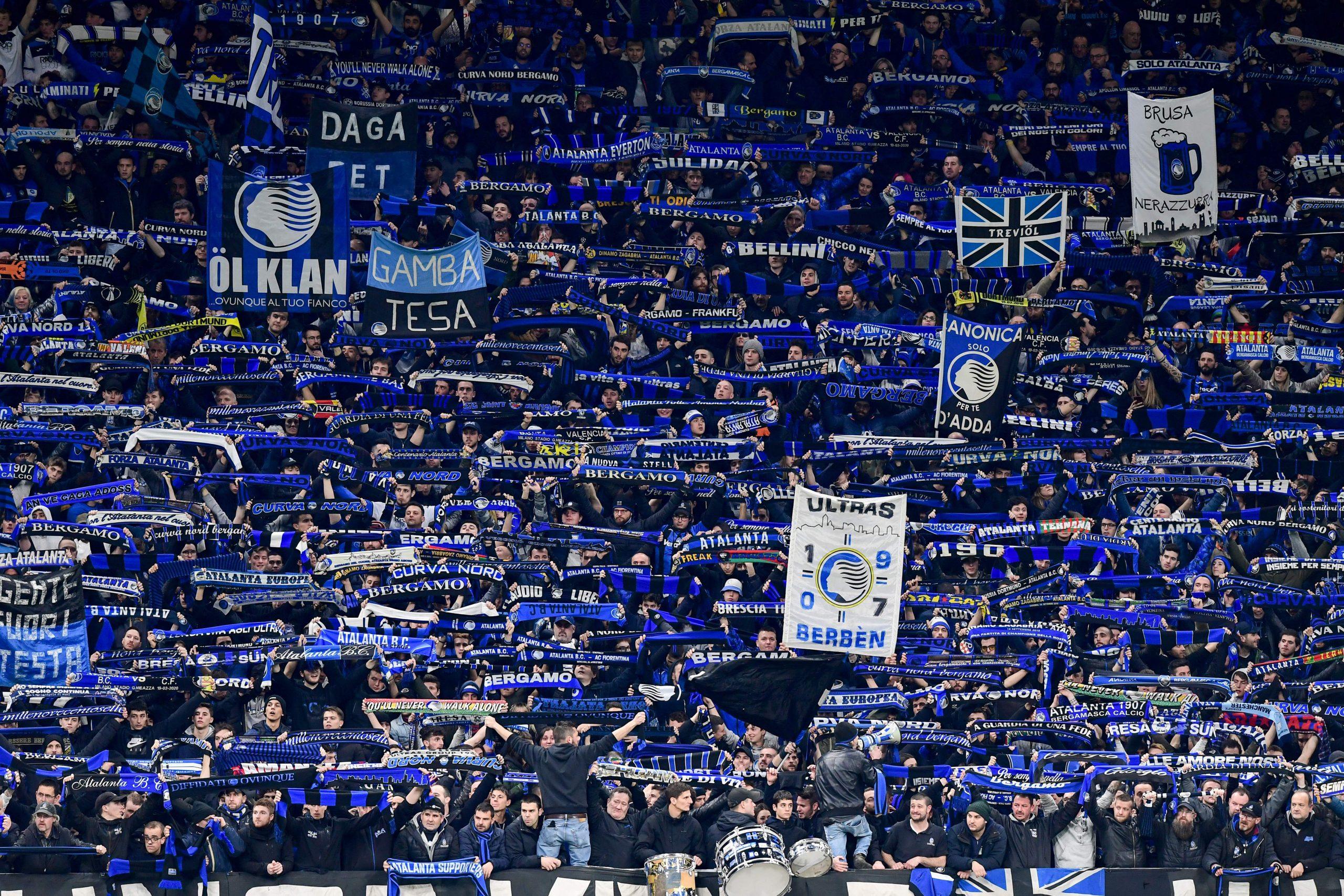 Atalanta fans cheer during the UEFA Champions League round of 16 first leg football match Atalanta Bergamo vs Valencia on February 19, 2020 at the San Siro stadium in Milan. (Photo by Miguel MEDINA / AFP) (Photo by MIGUEL MEDINA/AFP via Getty Images)