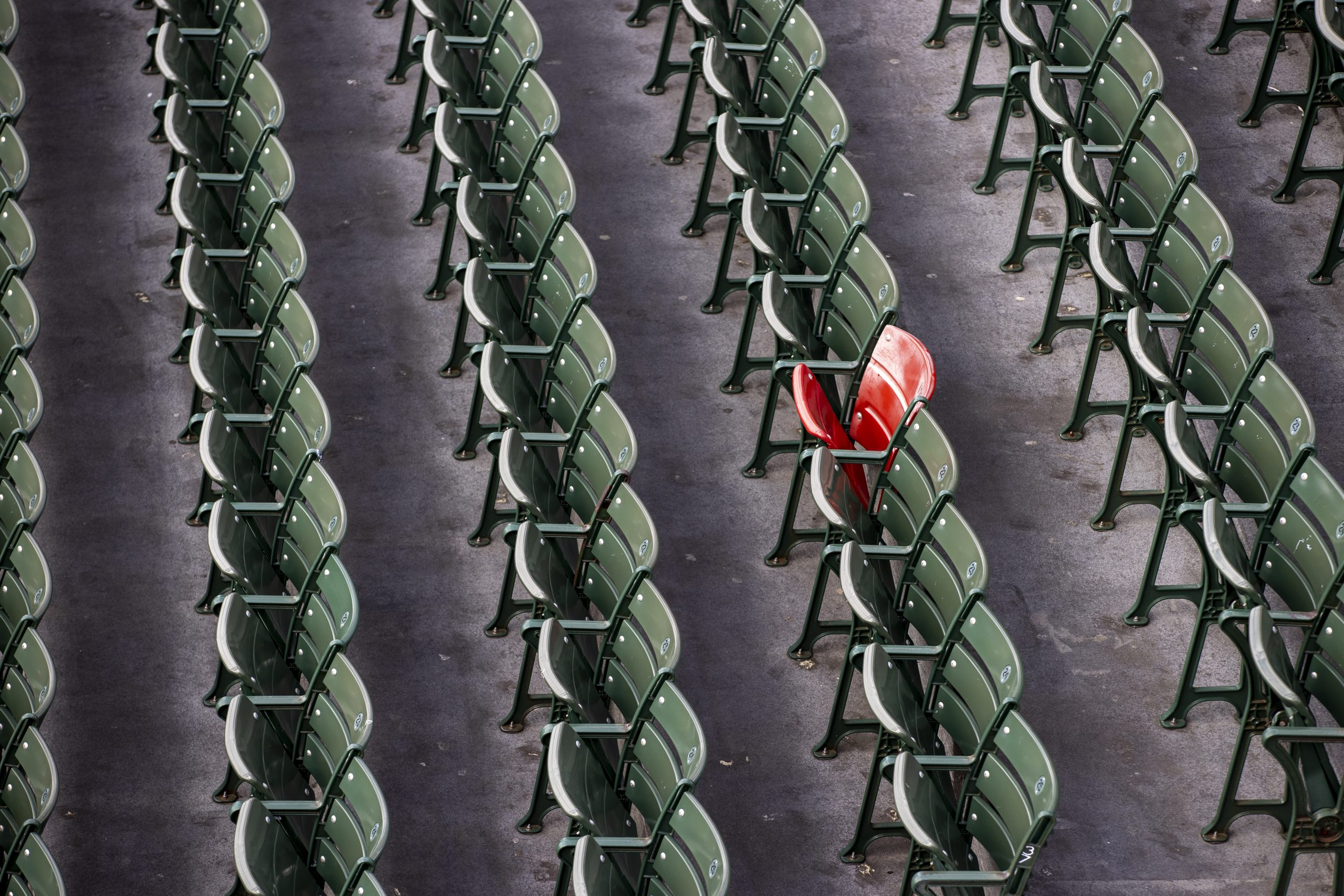 BOSTON, MA - APRIL 16: The red seat, which celebrates the longest home run hit in Fenway Park by Ted Williams, in the bleachers on April 16, 2020. Fenway Park in Boston remains closed during the coronavirus emergency. (Photo by Stan Grossfeld/The Boston Globe via Getty Images)