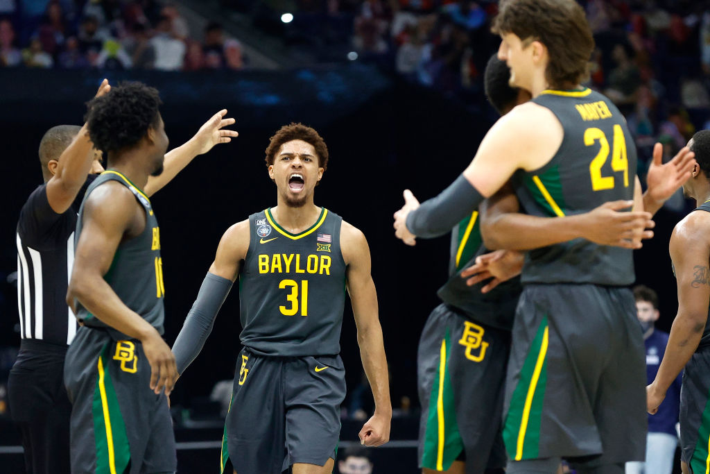 INDIANAPOLIS, INDIANA - APRIL 05: MaCio Teague #31 of the Baylor Bears reacts in the second half of the National Championship game of the 2021 NCAA Men's Basketball Tournament against the Gonzaga Bulldogs at Lucas Oil Stadium on April 05, 2021 in Indianapolis, Indiana. (Photo by Tim Nwachukwu/Getty Images)