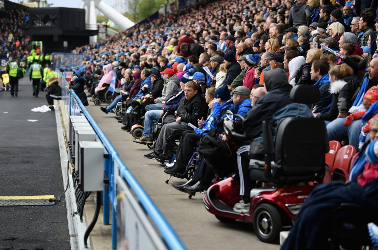 Disabled sports fans take in a live event.